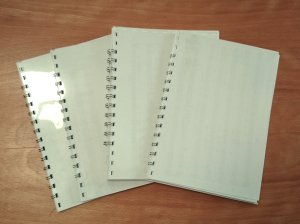 Four notebooks made from scrap paper and spare binding materials