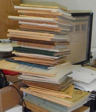 A teetering pile of scores