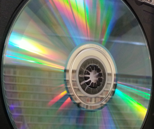 A CD with CD shelves reflected in it