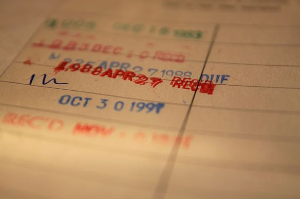 Picture of a library book's date label showing due date stamps