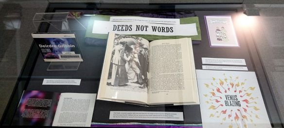 Library display case titled Deeds not Words showing items relating to Ethel Smyth, suffragettes and Venus Blazing at Trinity Laban